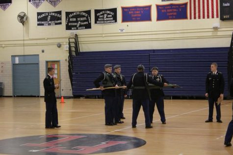 The RHS JROTC Unarmed Color Guard Team